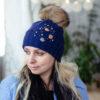 Вязаная шапка темно-синего цвета с декором от Wisteria